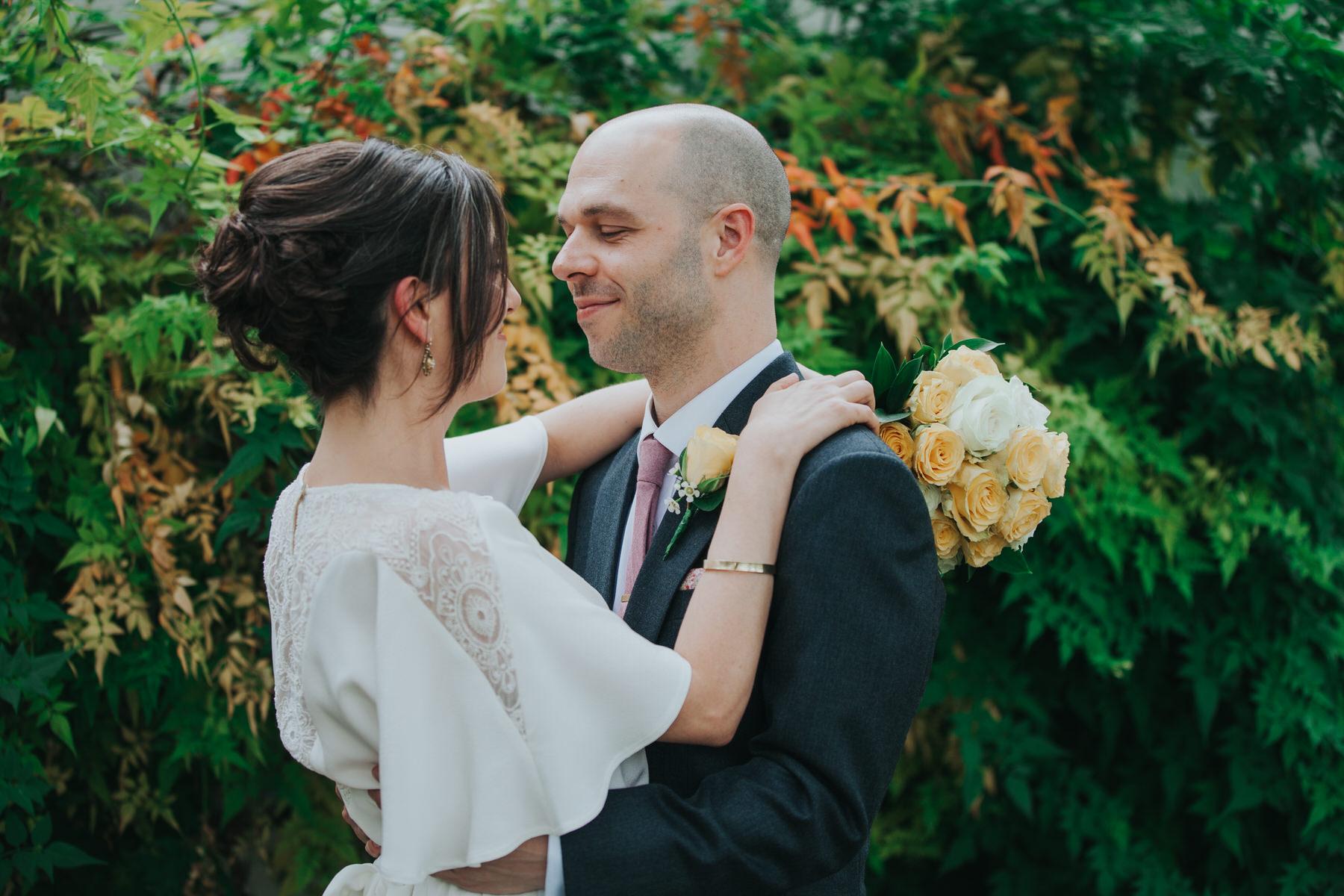 yellow bride groom embracing romantic portraits.jpg