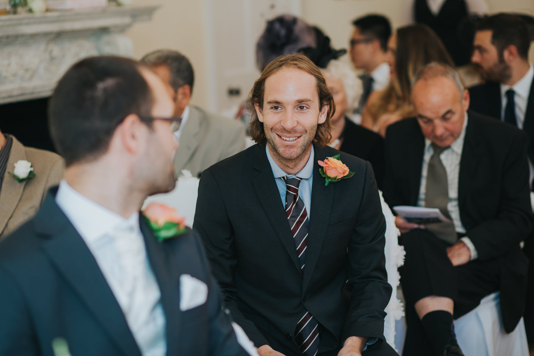 38 bestman chatting groom Pembroke Lodge wedding ceremony.jpg