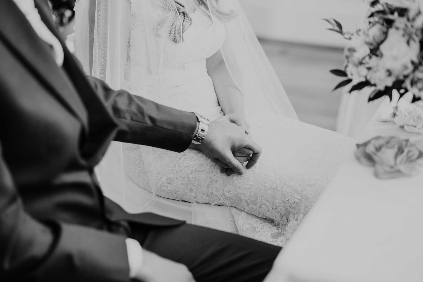 58 groom holds brides hand BW wedding ceremony.jpg
