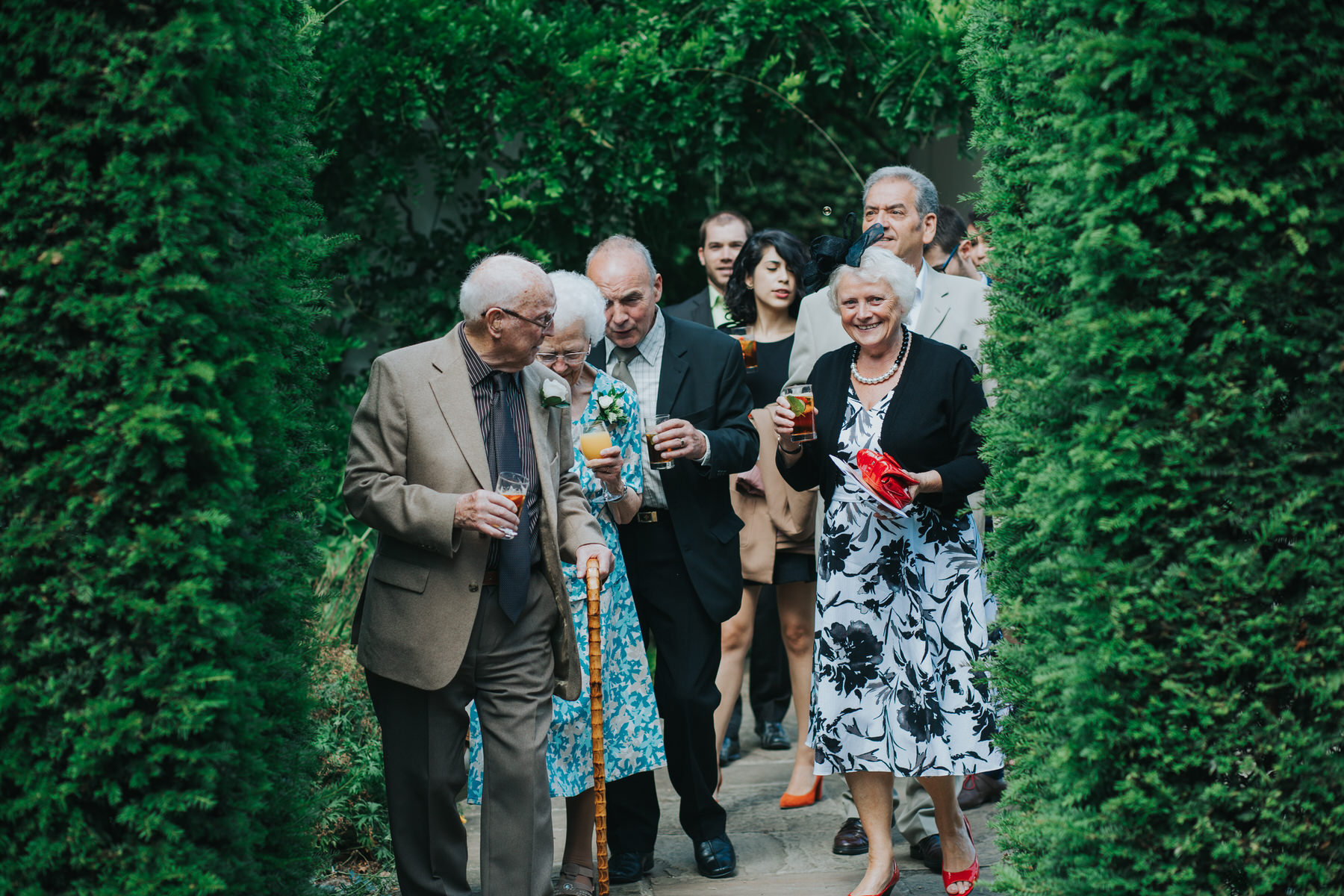 95 Pembroke Lodge South Lawn wedding guests arriving drinks reception.jpg