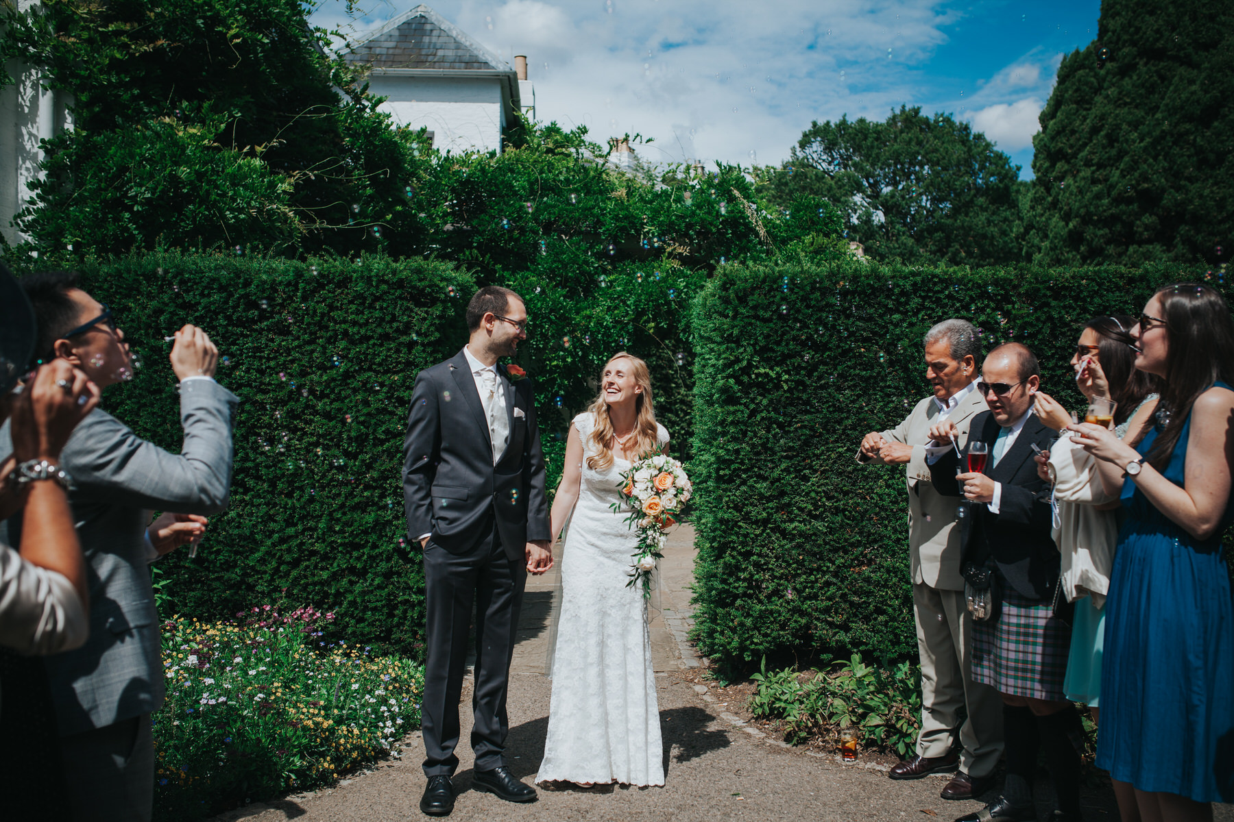 104 confetti blowing bubbles Pembroke Lodge South Lawn wedding photography.jpg