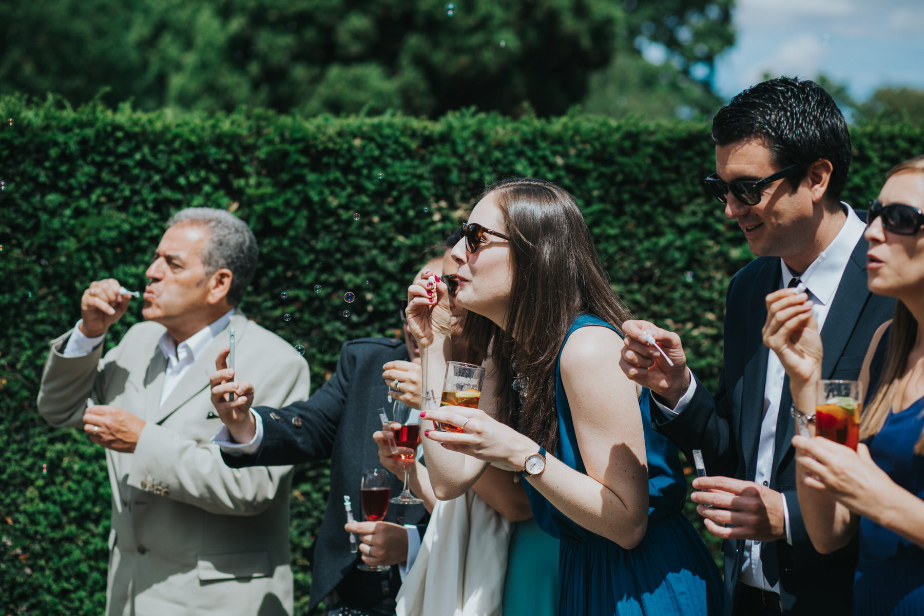 110 Pembroke Lodge South Lawn wedding guests blowing bubbles.jpg