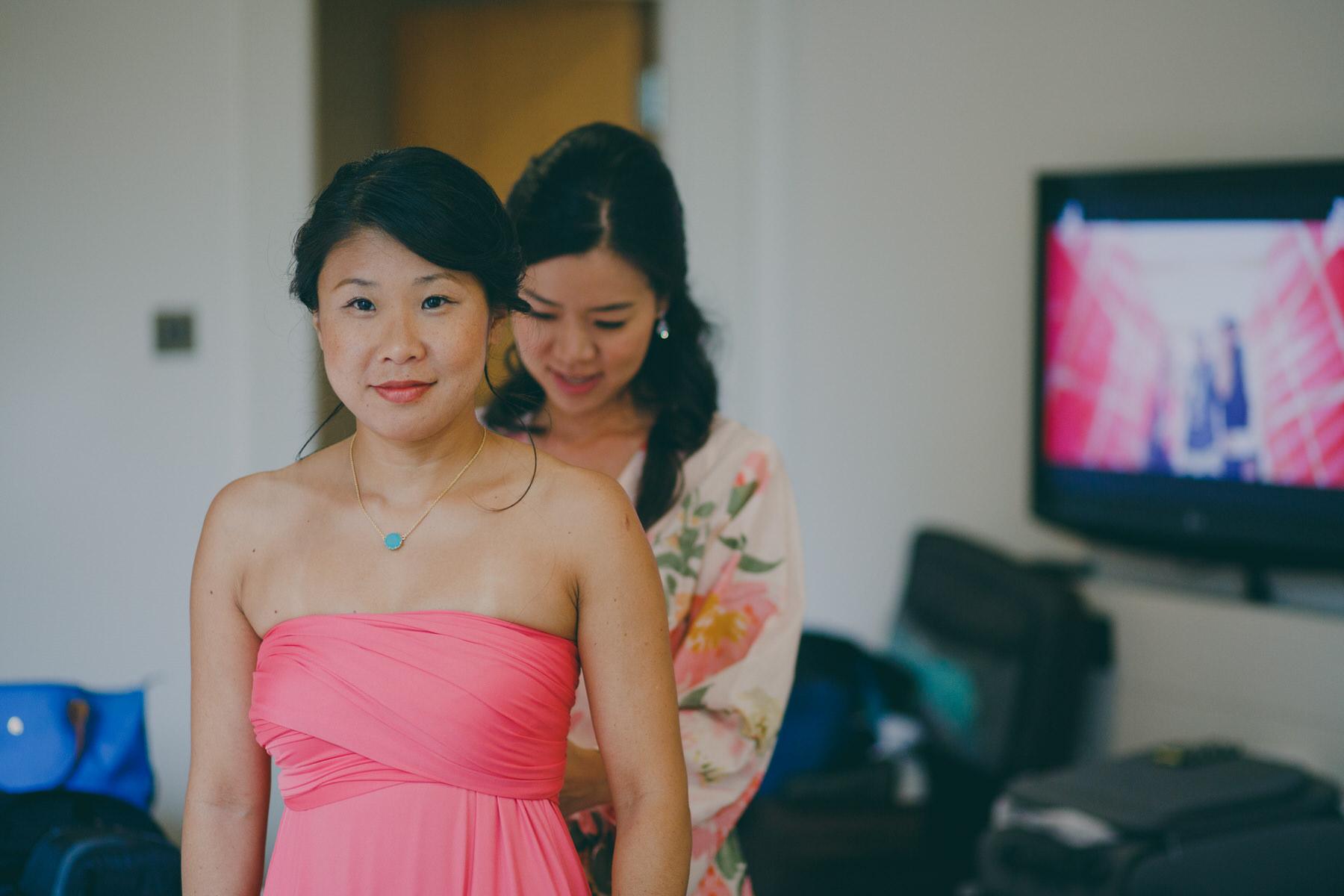 53 bride helping bridesmaid hot pink dress.jpg