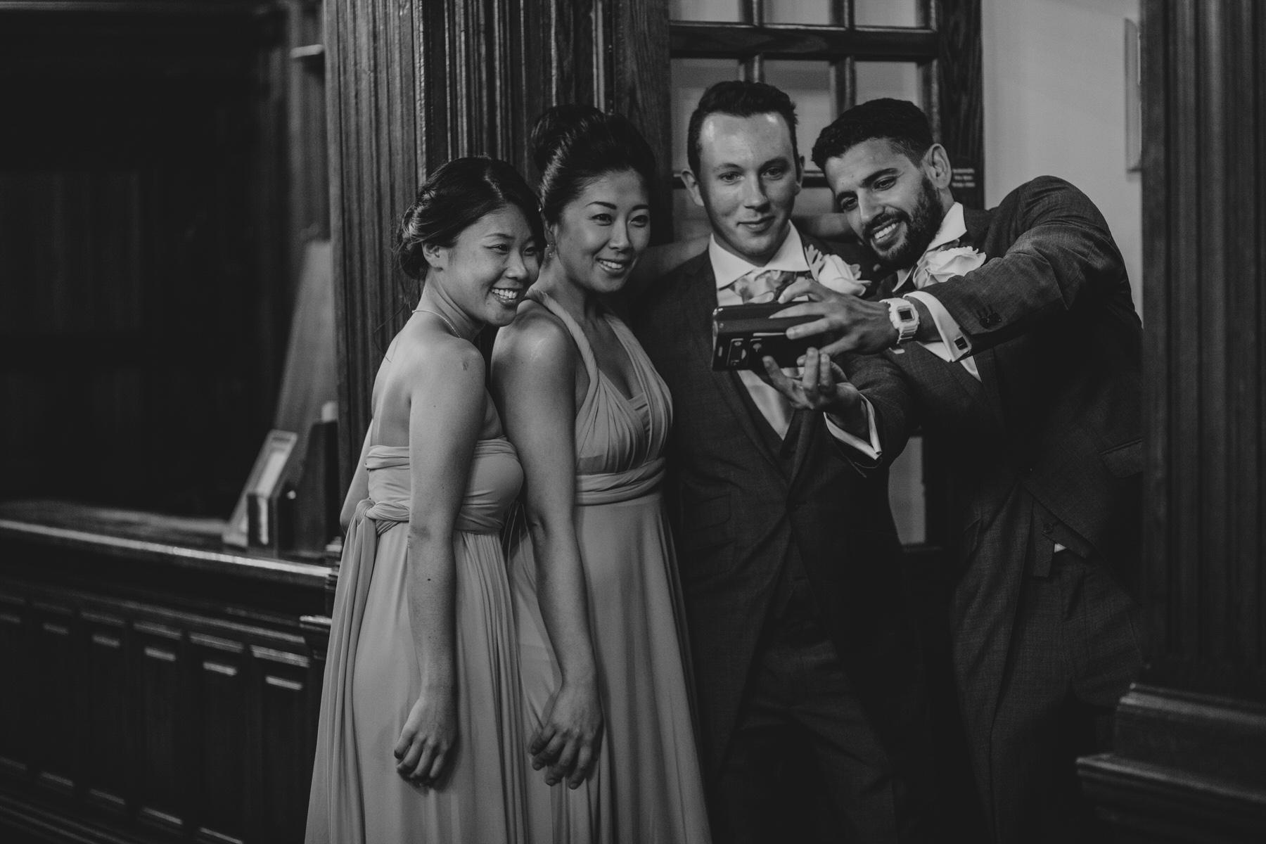135 bridesmaids ushers take selfie reportage photographer.jpg