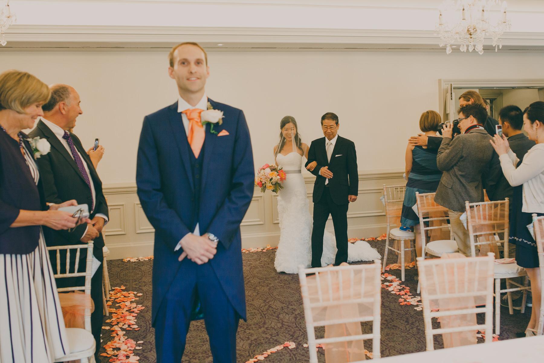 160 groom waits bride walks down aisle with dad.jpg