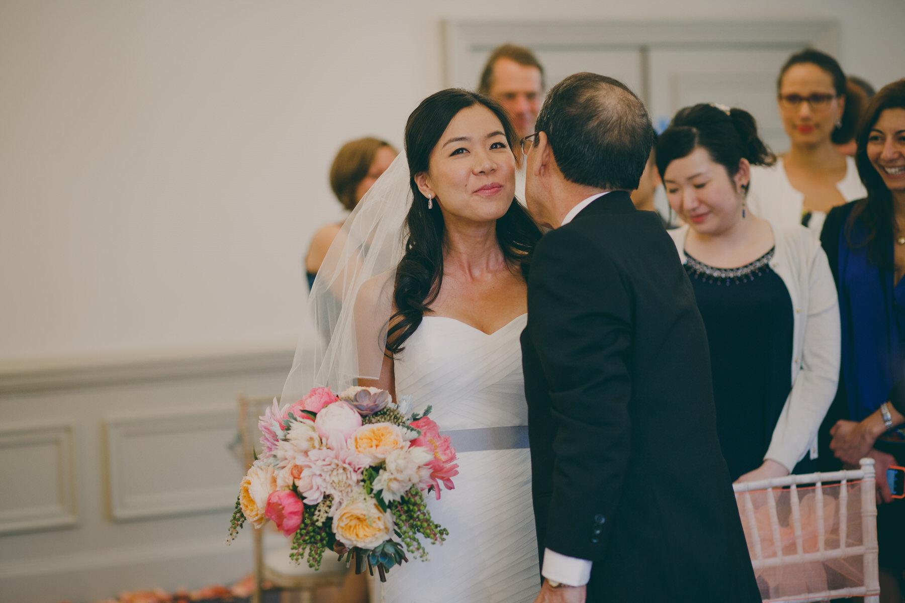 167 father kisses bride Surrey documentary wedding photographer.jpg