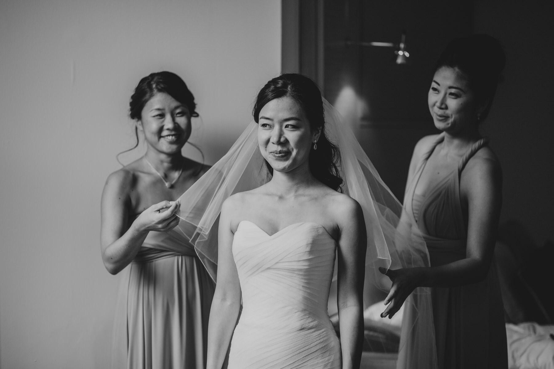 80 pleased bride Enzoani dress reportage wedding photographer London.jpg
