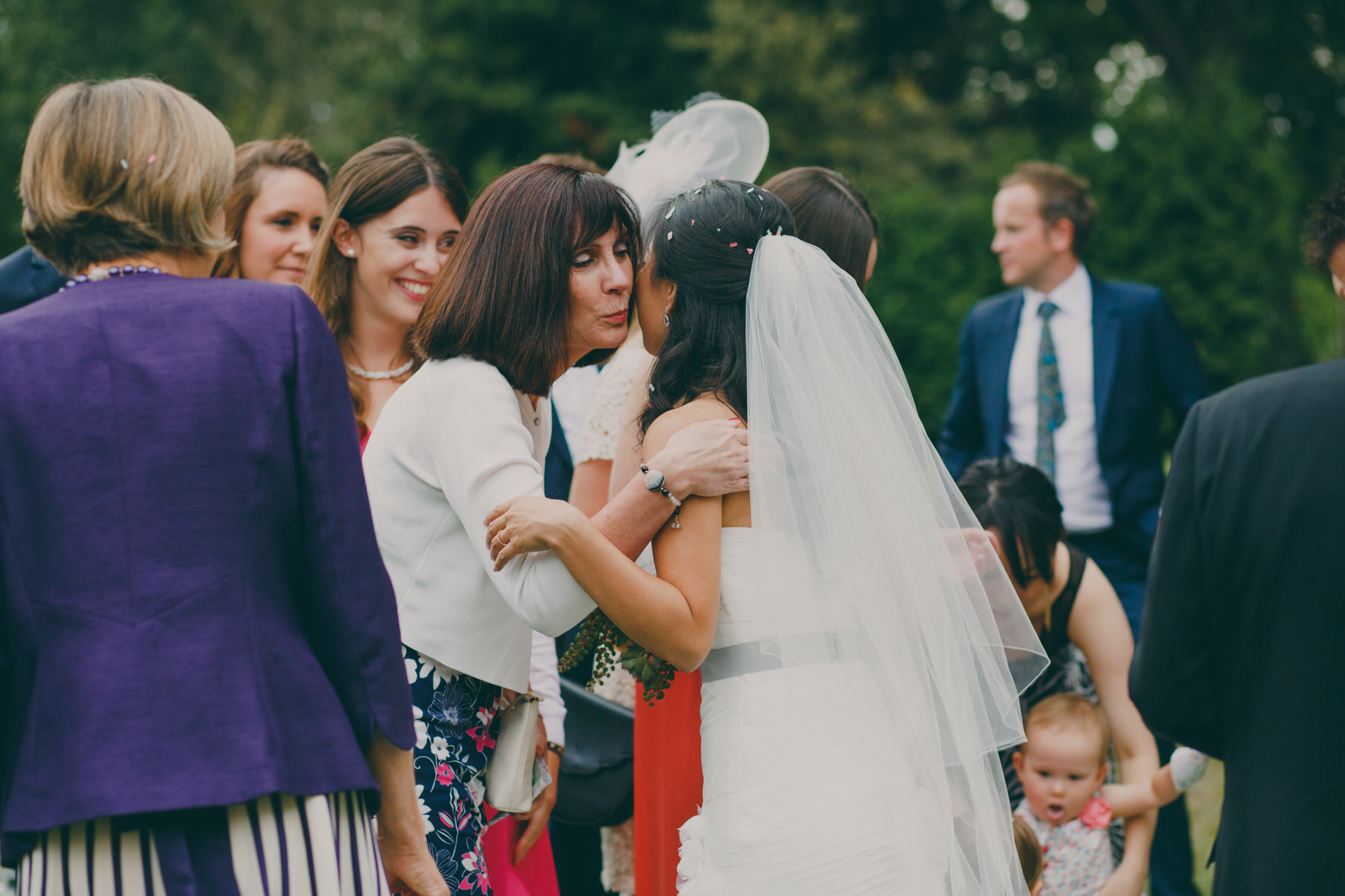 239 Surrey wedding reception drinks guest candid reportage.jpg