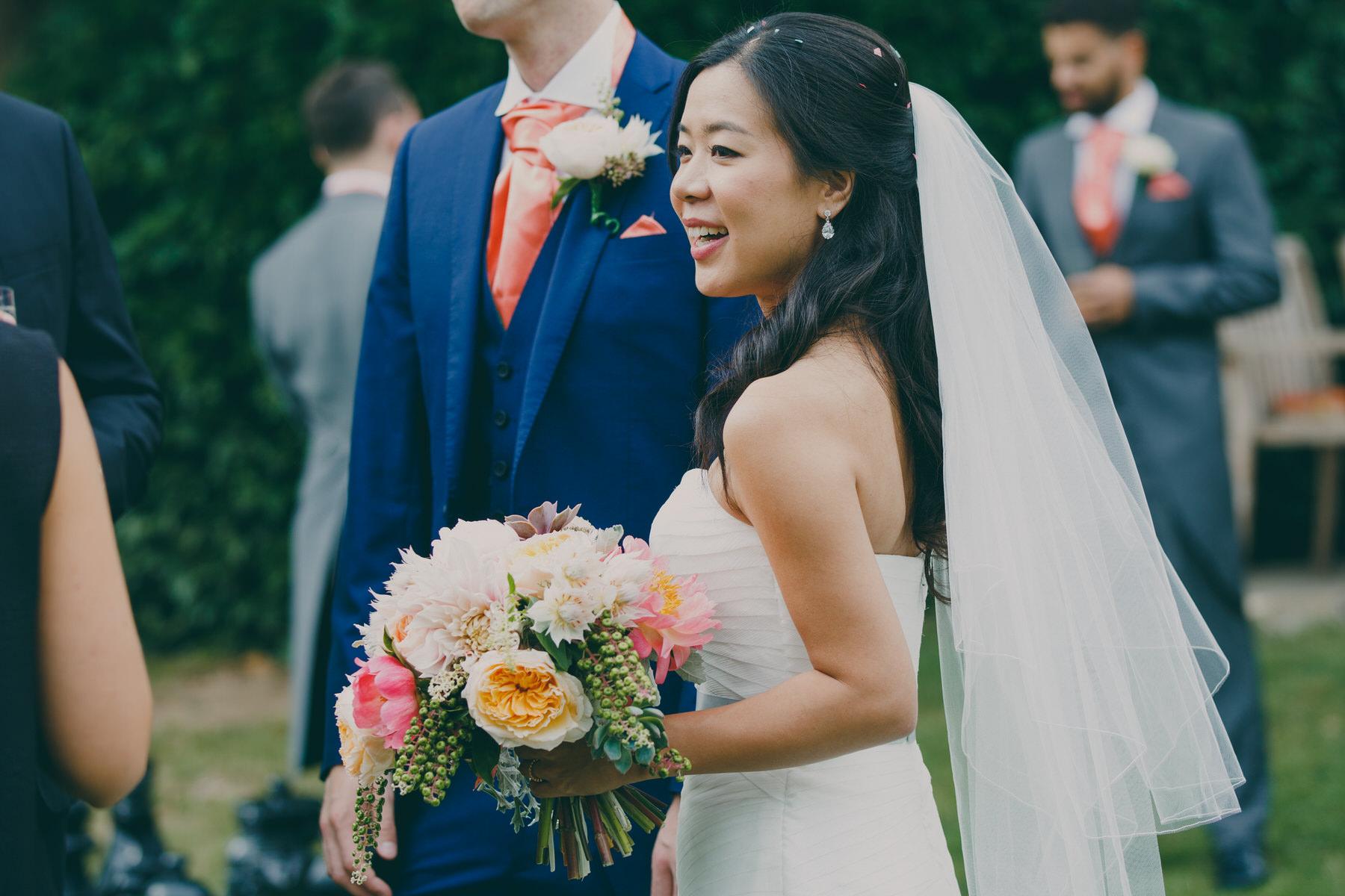 250  Surrey wedding reception drinks bride candid reportage.jpg