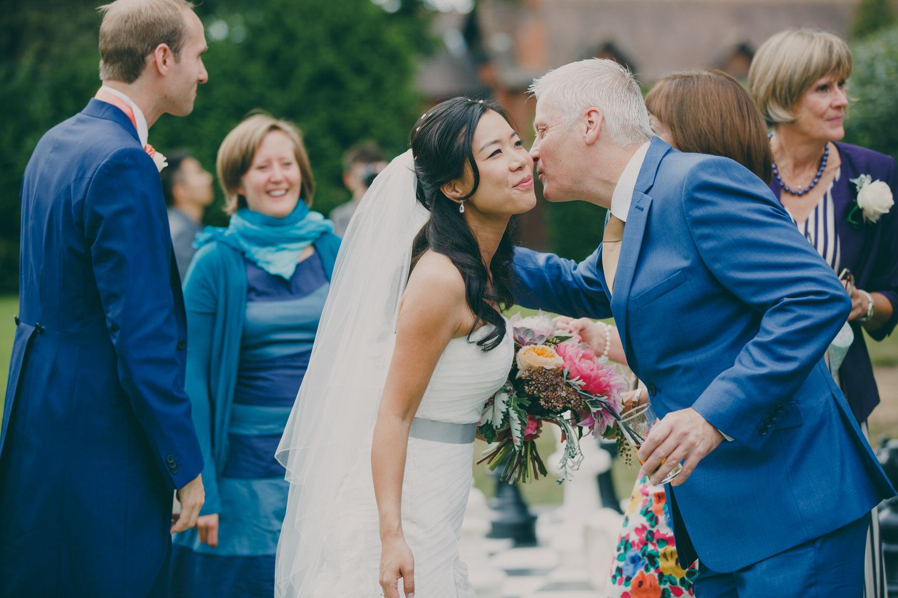256 Surrey wedding reception drinks guest candid reportage.jpg
