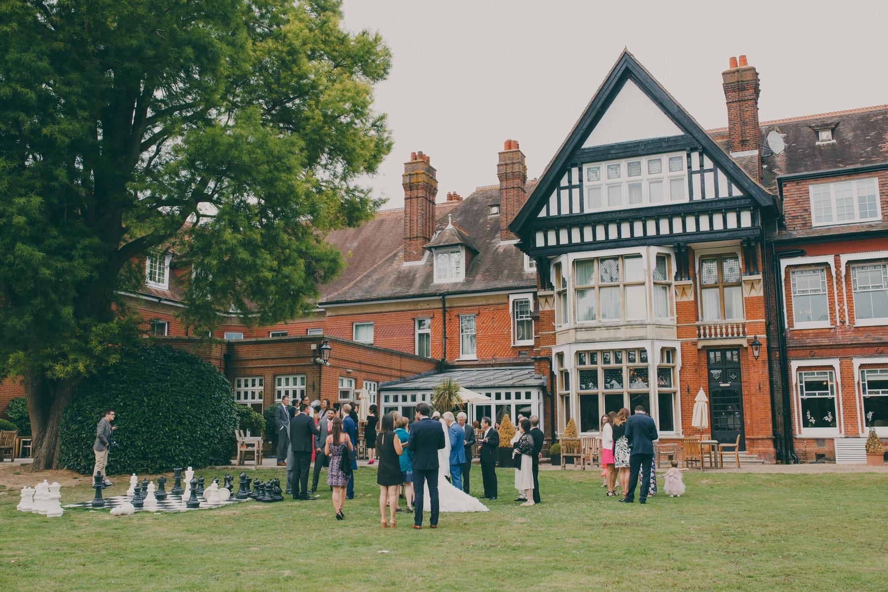 258 Woodlands Hotel  Surrey wedding reception drinks guest candid reportage.jpg