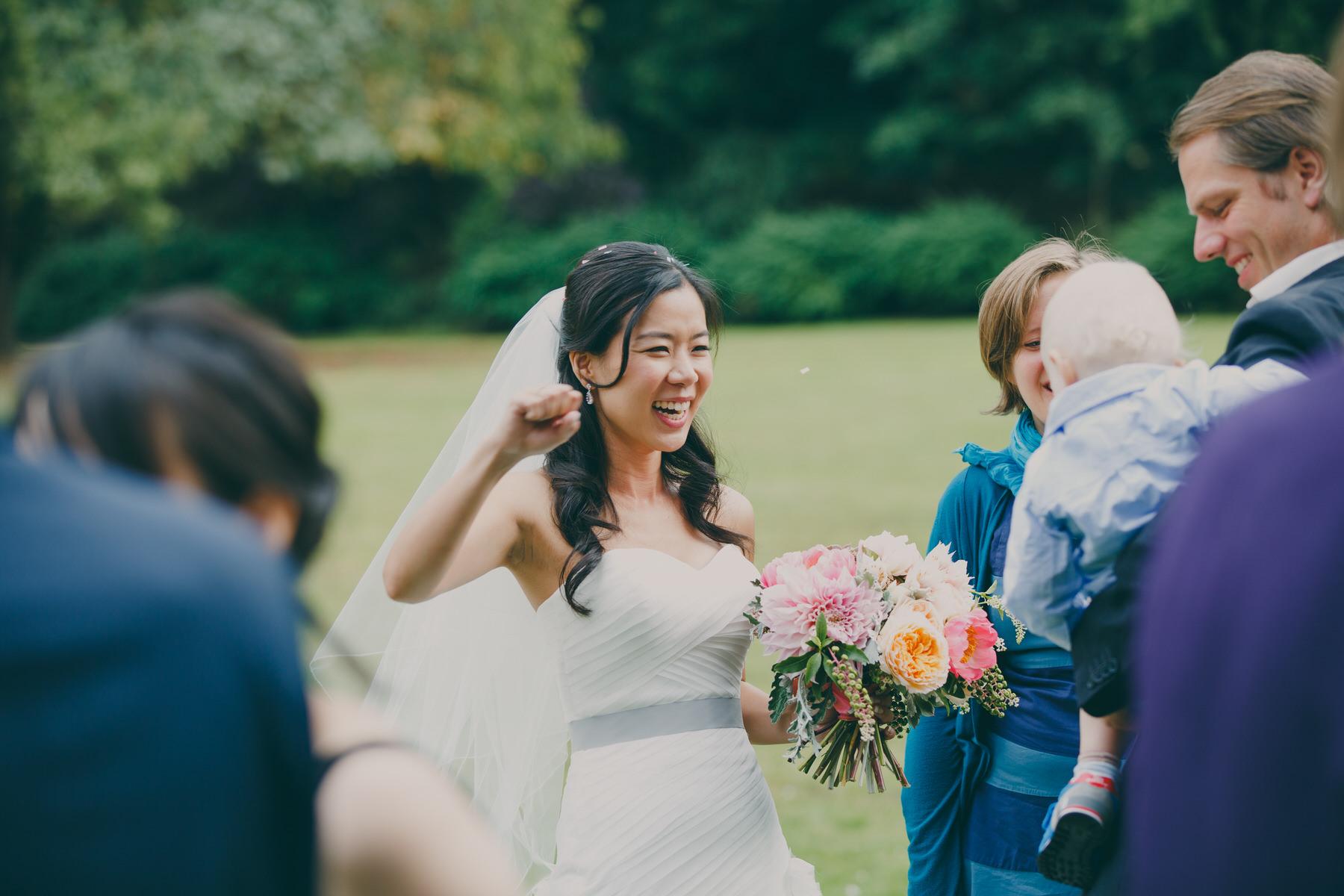 262 bride fist pumps  Surrey wedding reception reportage.jpg