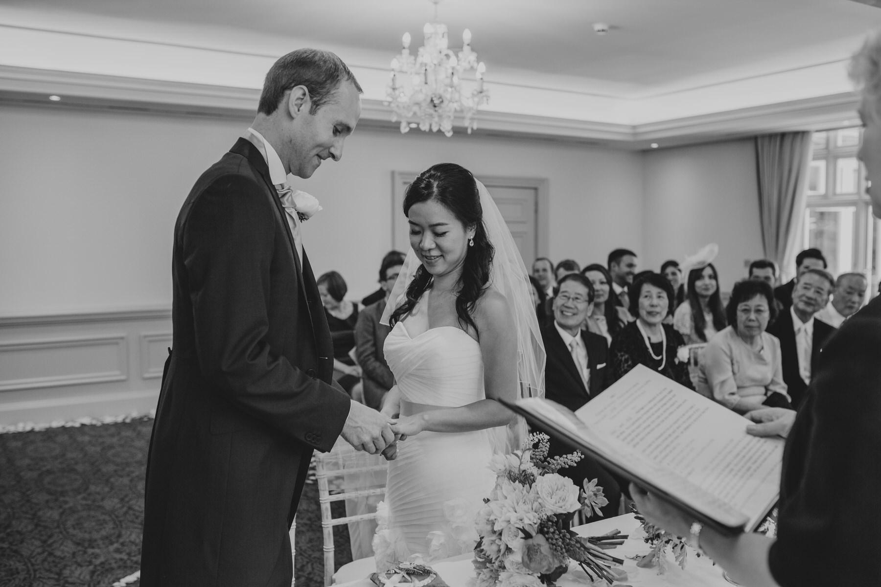 186 bride groom exchange rings Woodlands Hotel.jpg