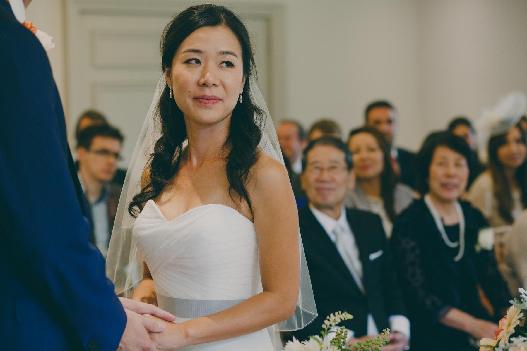 195 brides parents look on at bride wedding ceremony.jpg