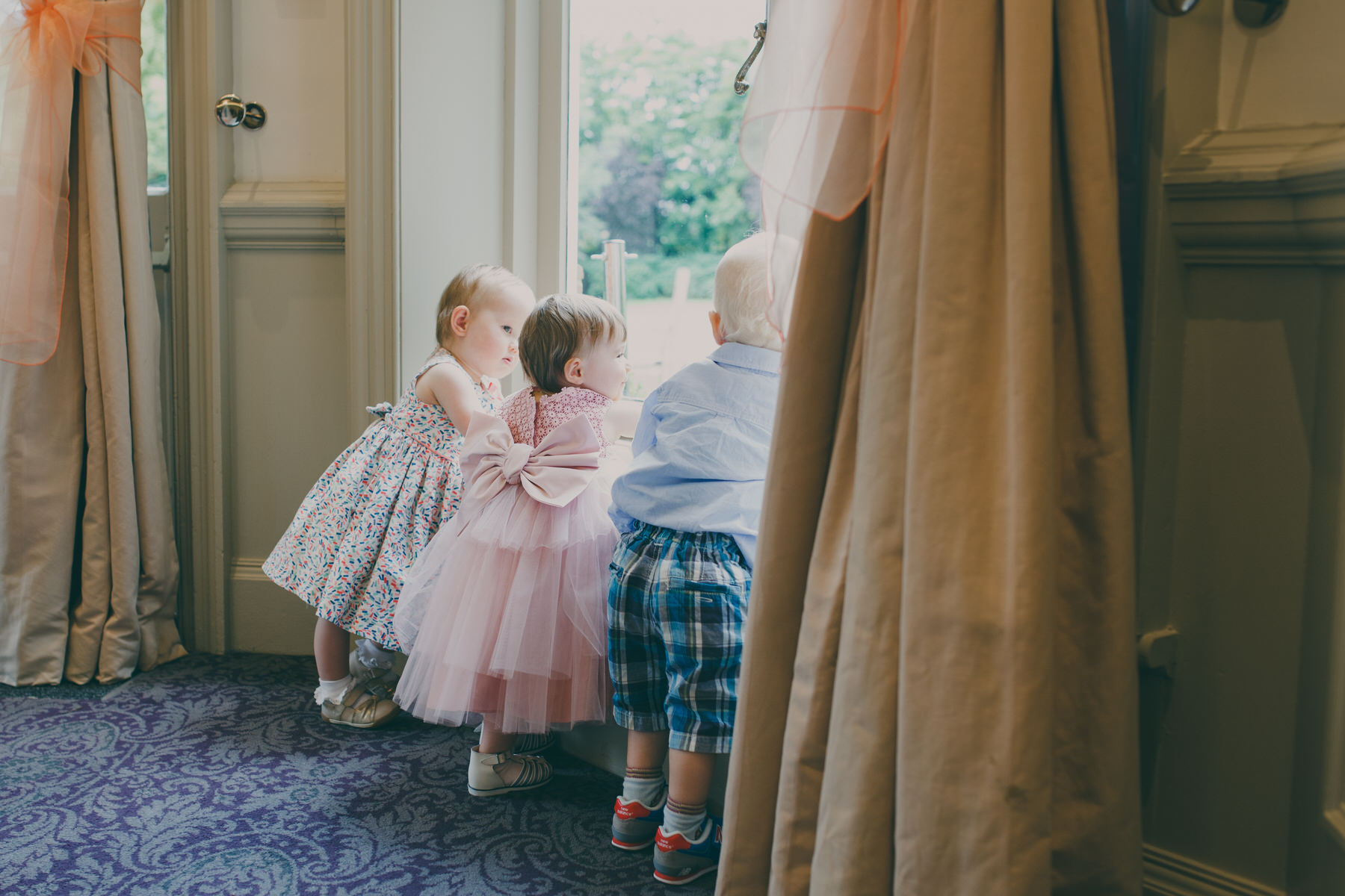 217 child wedding guests look out the window.jpg