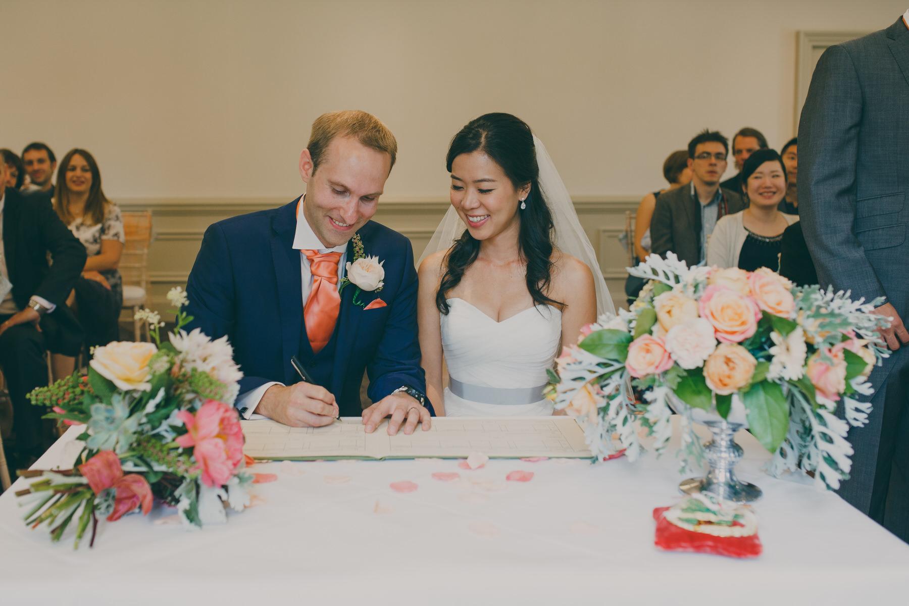 204 signing register Surrey documentary stle wedding photography.jpg