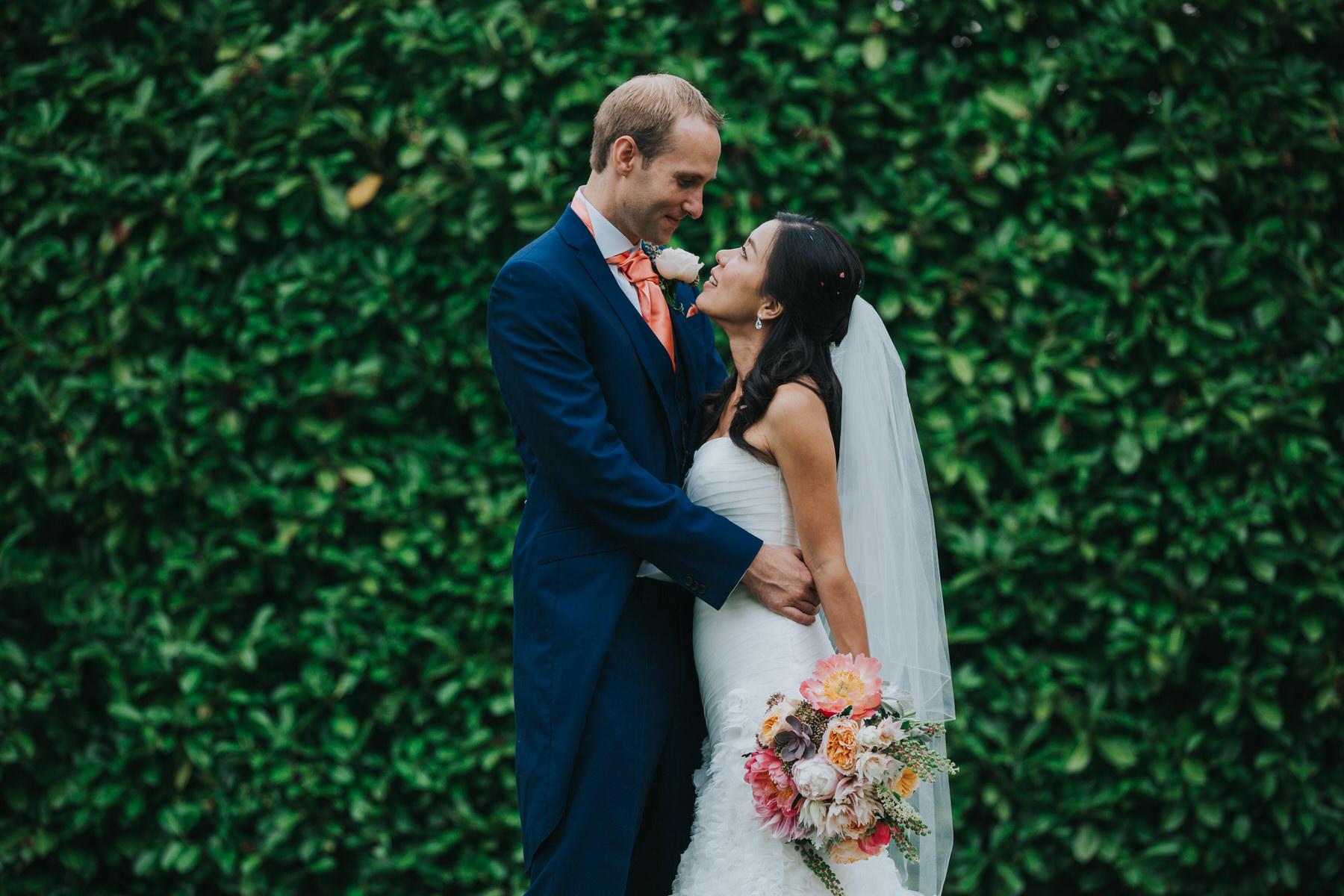 331 bride groom wedding portraits Woodlands Hotel green hedge.jpg