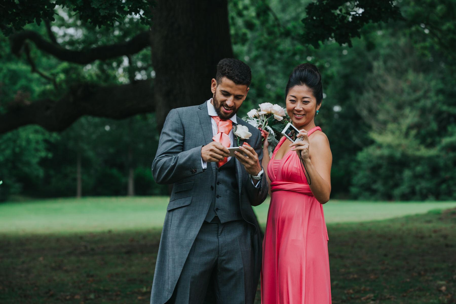 359 usher bridesmaid selfie reportage wedding photographer.jpg