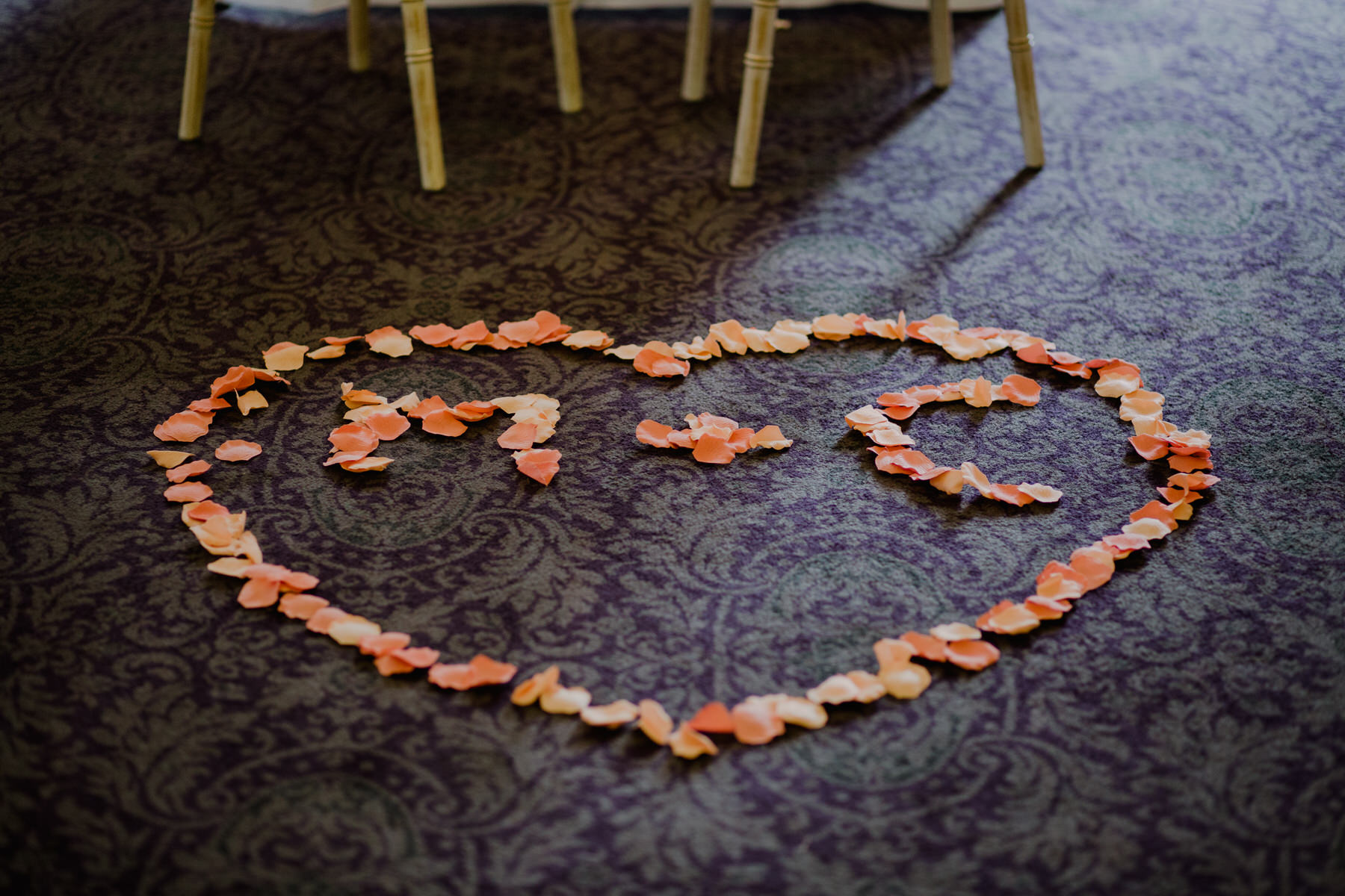 96 heart M C letters in rose petals ceremony room.jpg