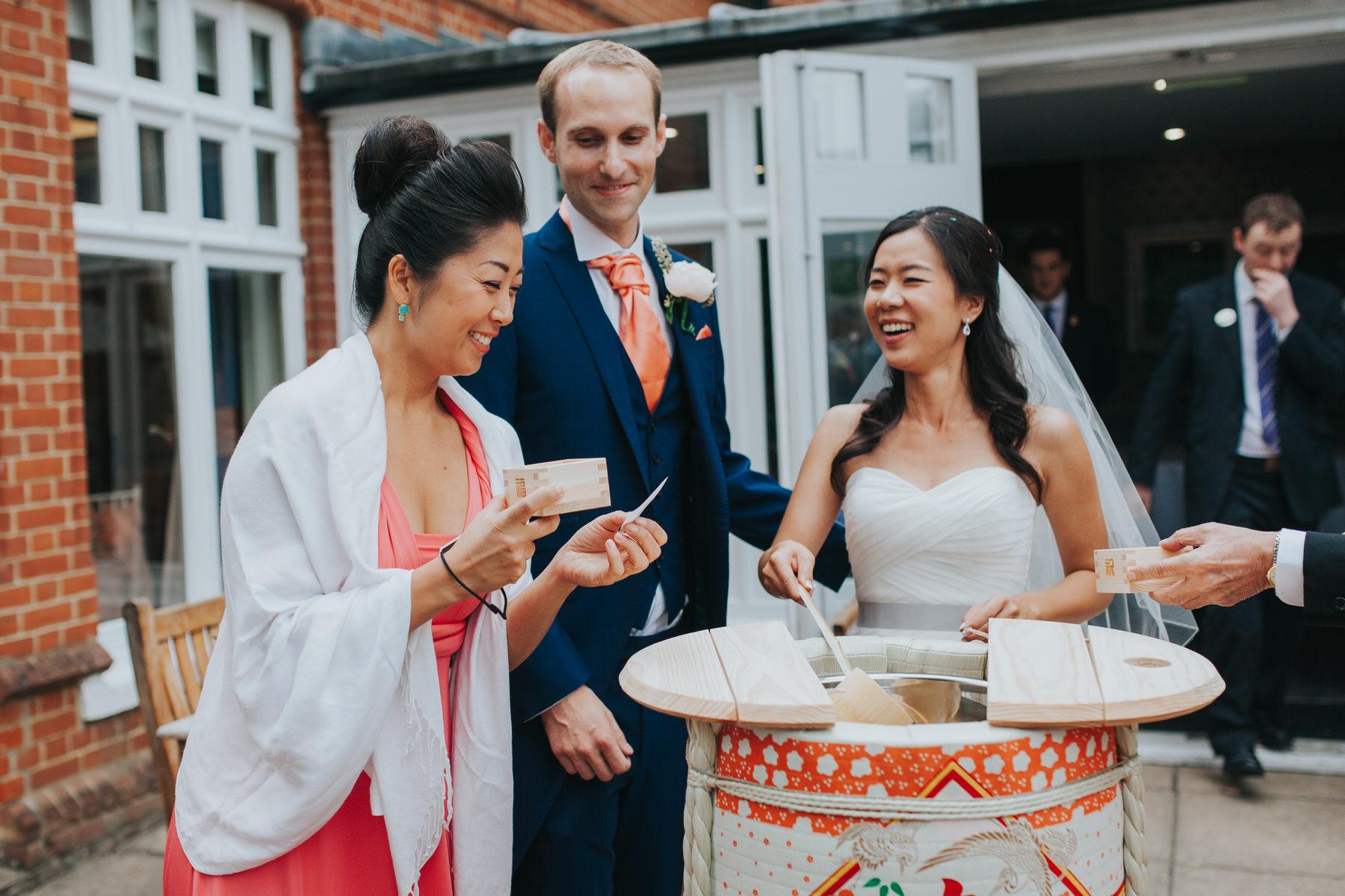 295- Chinese tea ceremony Surrey wedding photographer.jpg