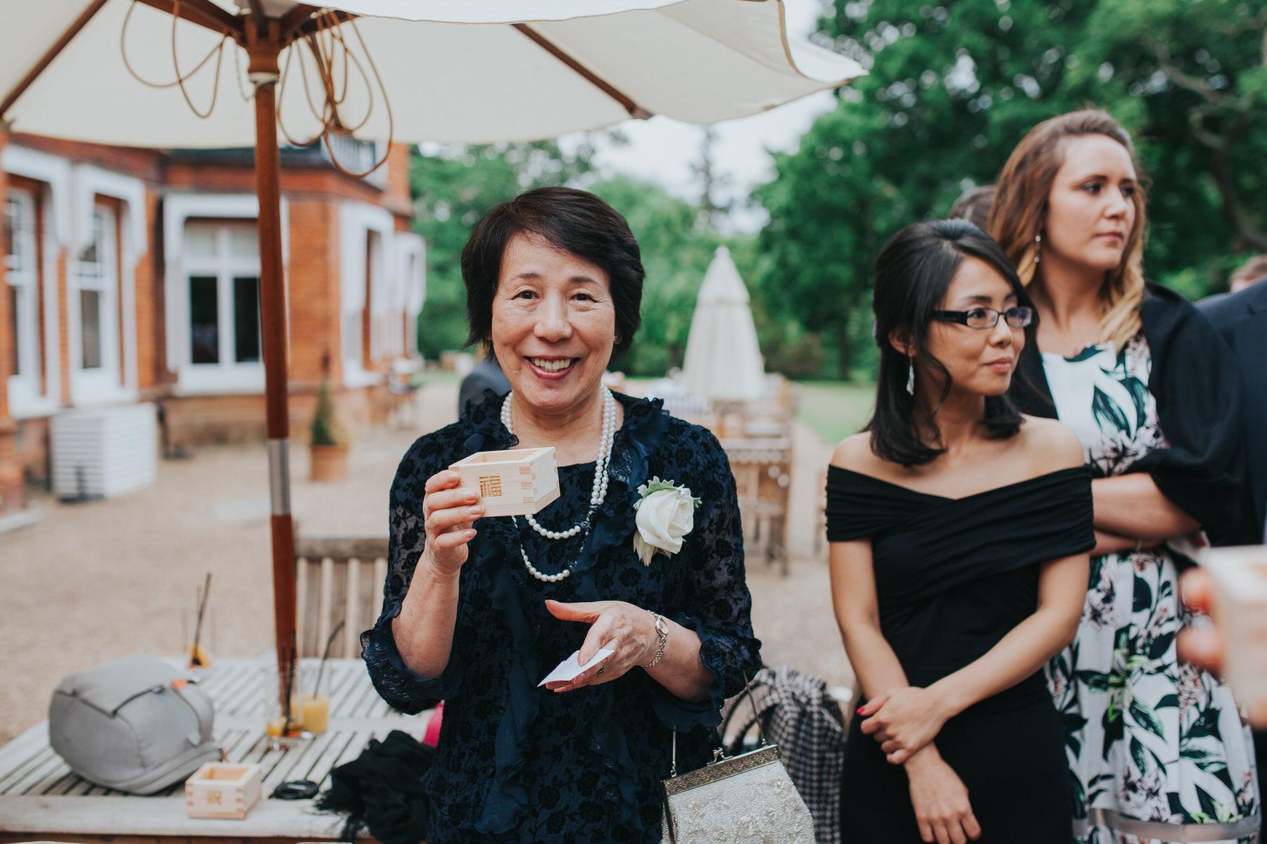 300- Chinese tea ceremony Surrey wedding photographer.jpg