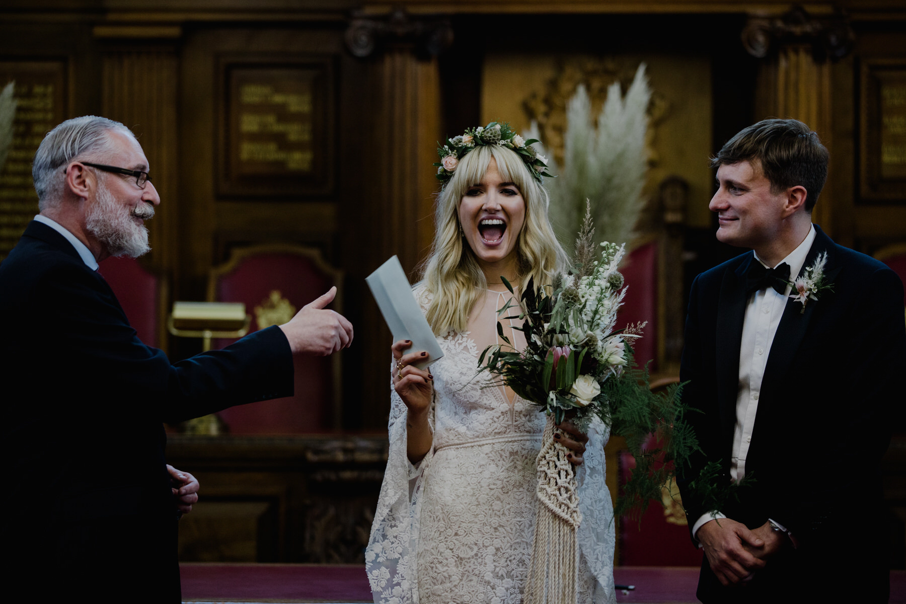 bride receiving marriage certificate London wedding photographer.jpg
