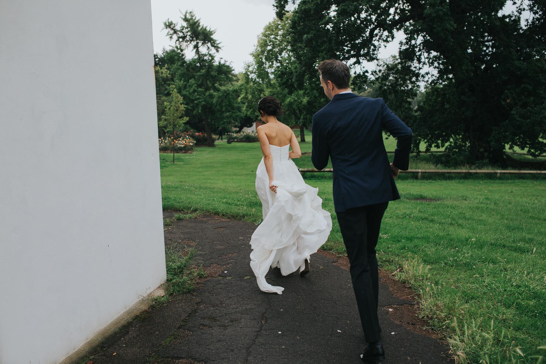 466 Belair House bride groom running away rain.jpg