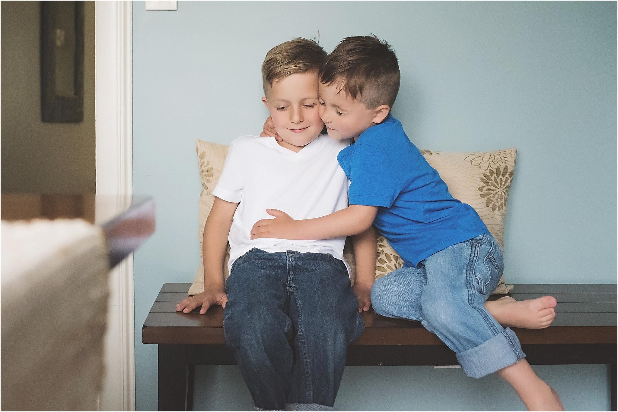 karra lynn photography - family lifestyle photographer michigan - brothers hugging