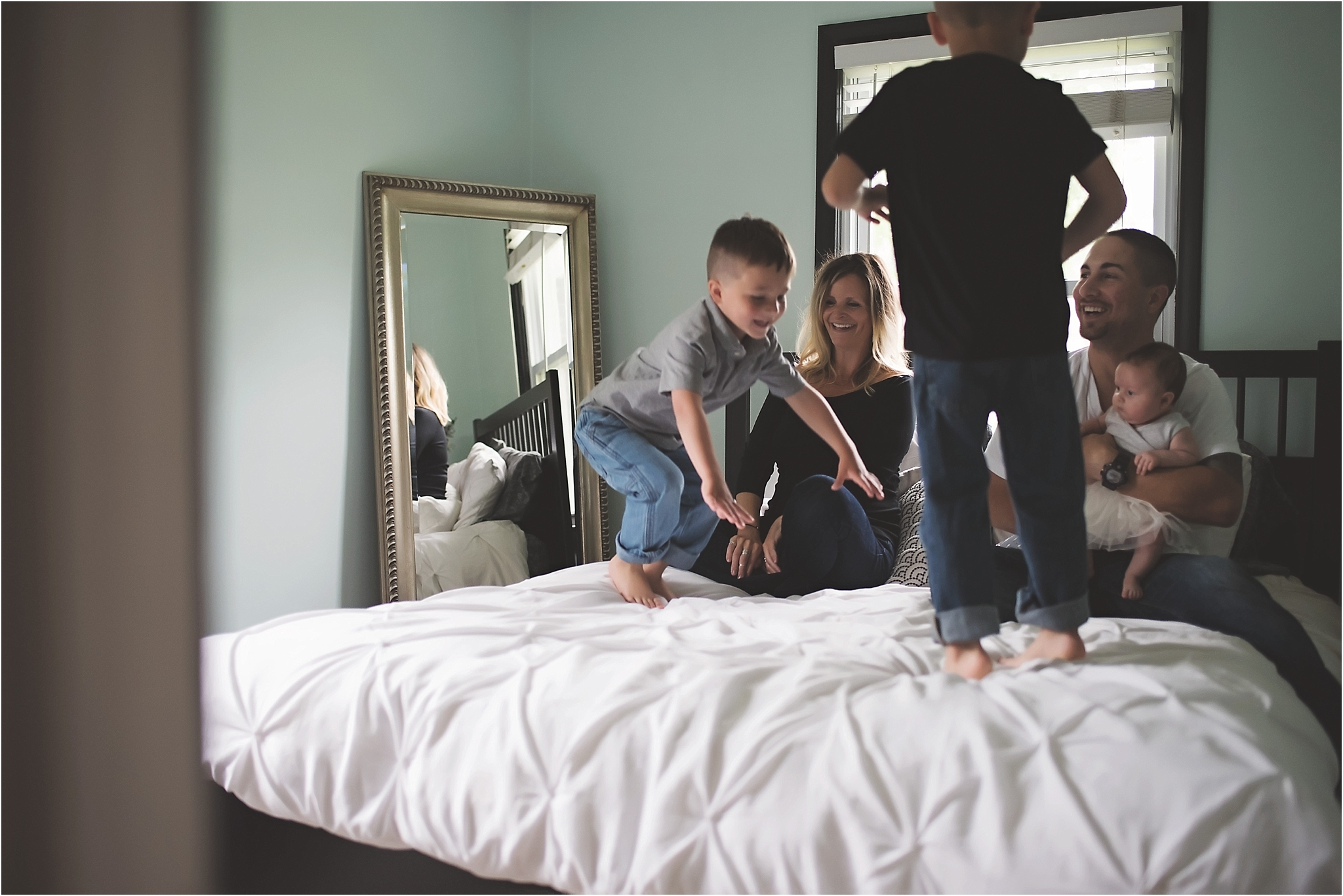 karra lynn photography - family lifestyle photographer michigan - jumping on the bed