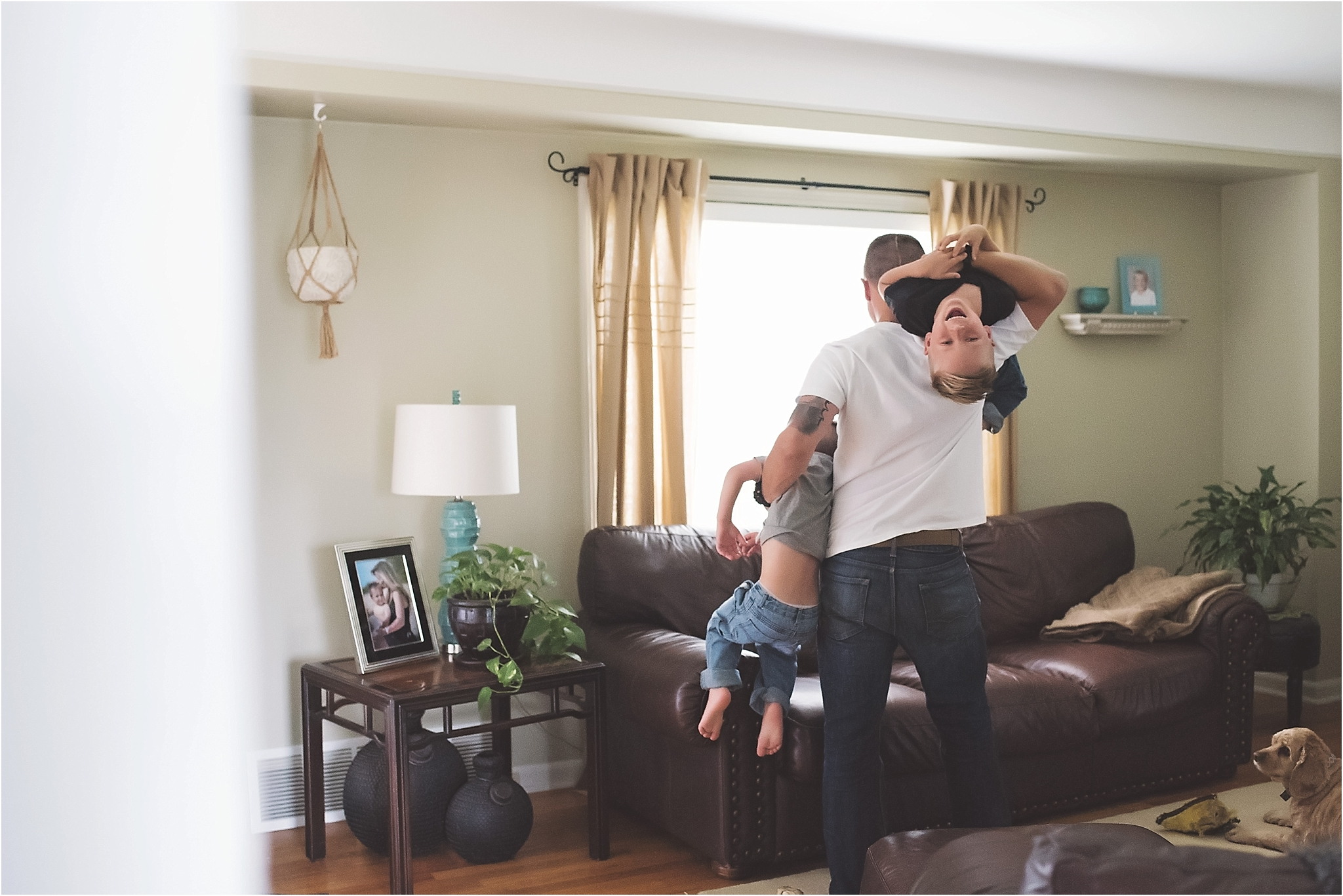 karra lynn photography - family lifestyle photographer michigan - dad and sons playing