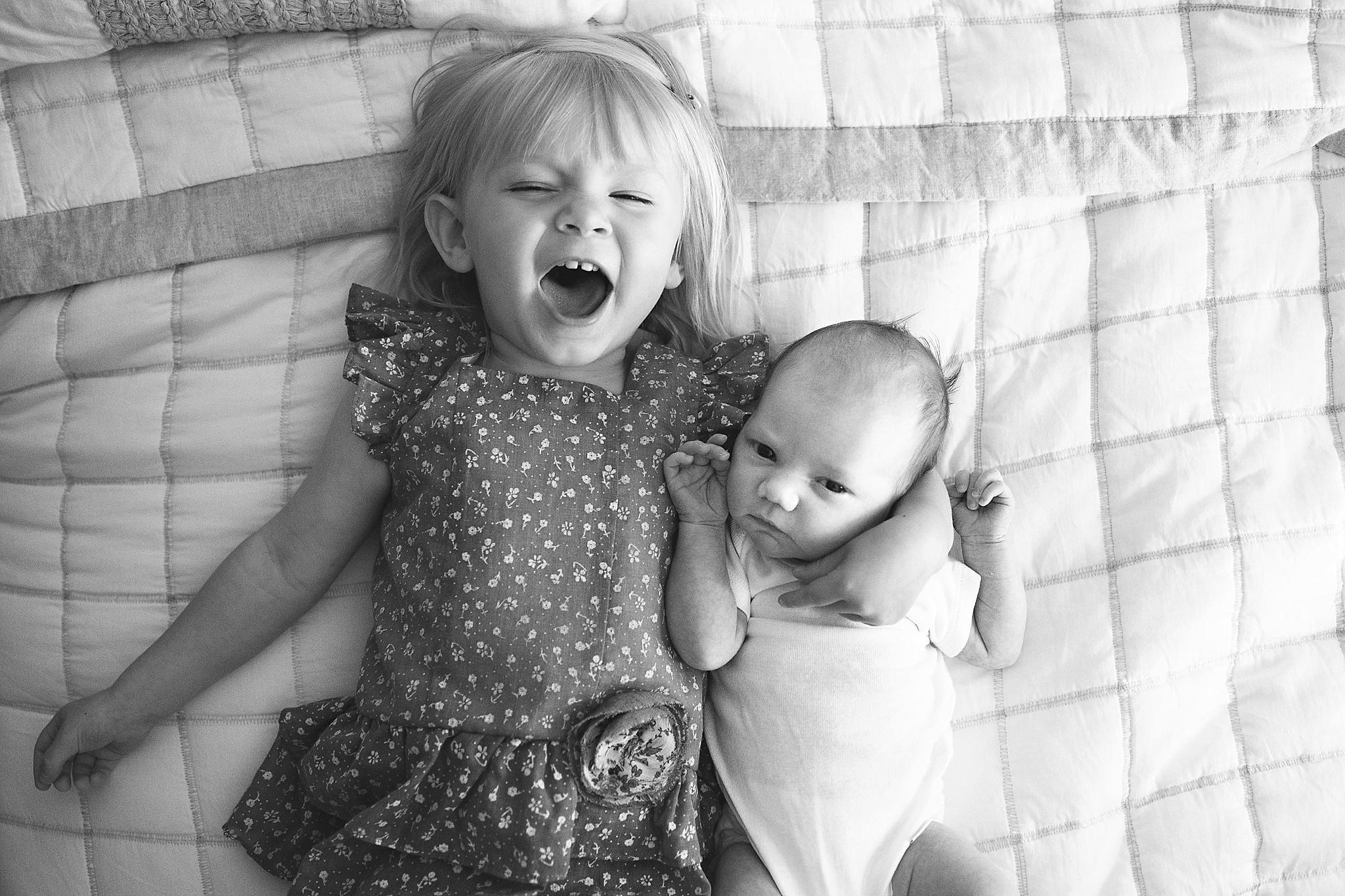 karra lynn photo lifestyle newborn at home - sister pose