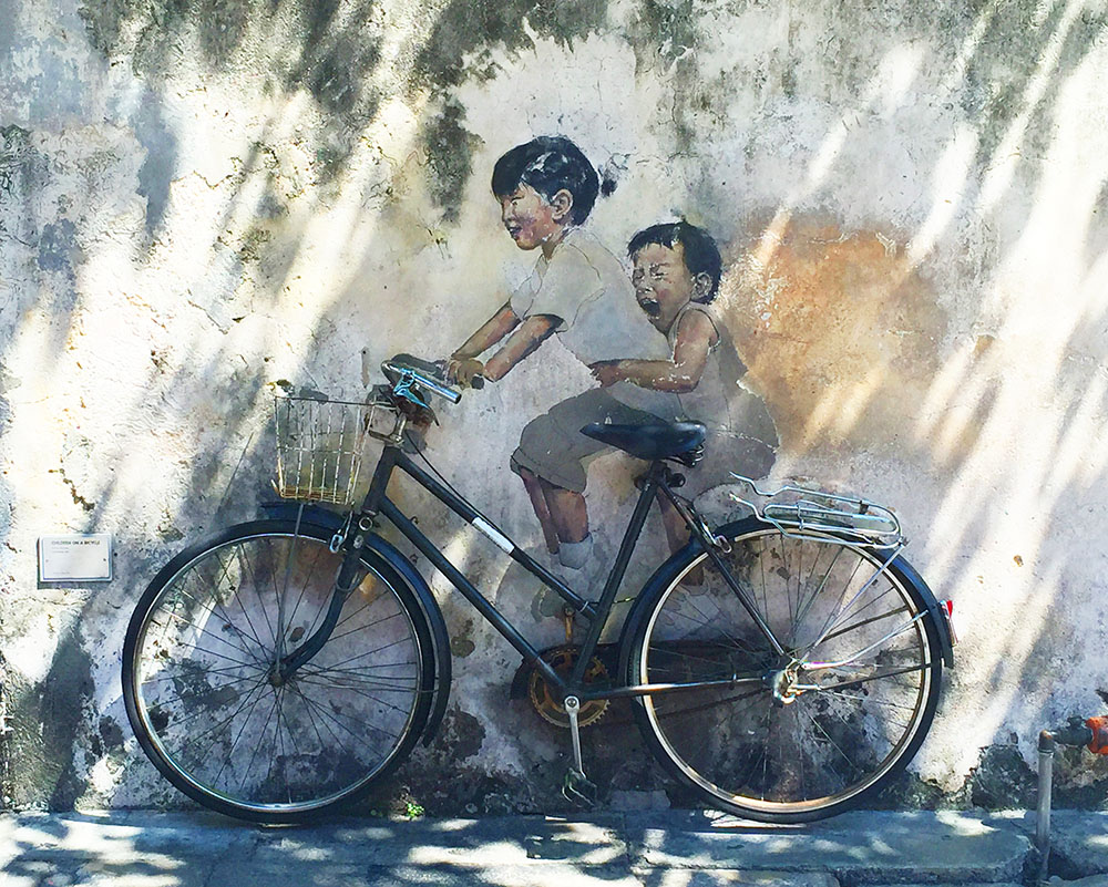 How stunning is this? If you look closely you'll see that the bike is actually real. It's been fastened to the wall over the painting!