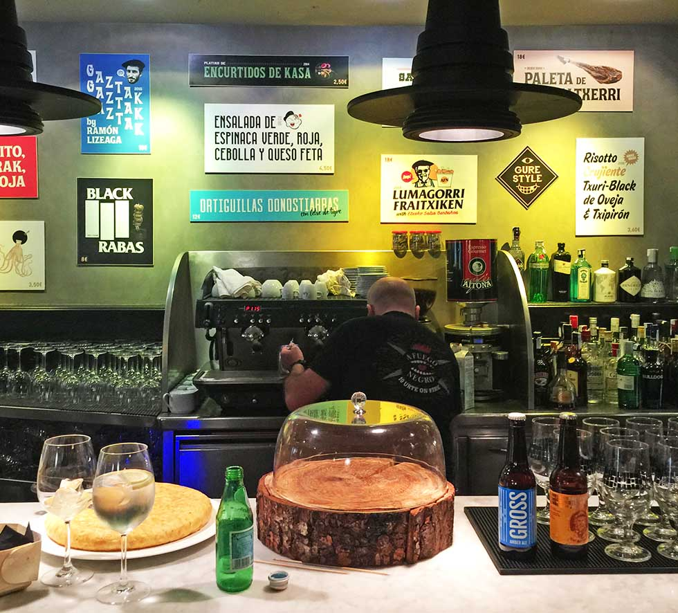The hip interior at A Fuego Negro. Those signs on the back all represent different pintxos available to order. Spanish isn't used much here, where the locals speak Basque.