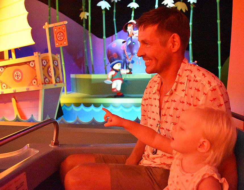 """Rosie and Justin both in awe of the magic of the """"It's a small world"""" ride at Disneyland."""