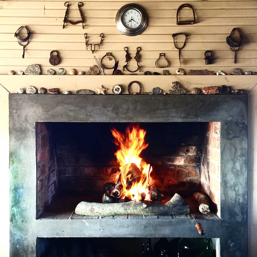 The roaring fire at Chez Silvia, and a wonderful collection of found objects on the mantel.