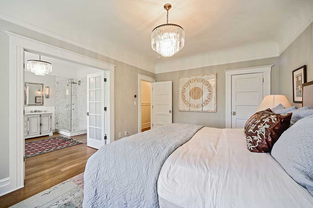 I love the double French doors between the bedroom and the bathroom, they make the space feel so open.