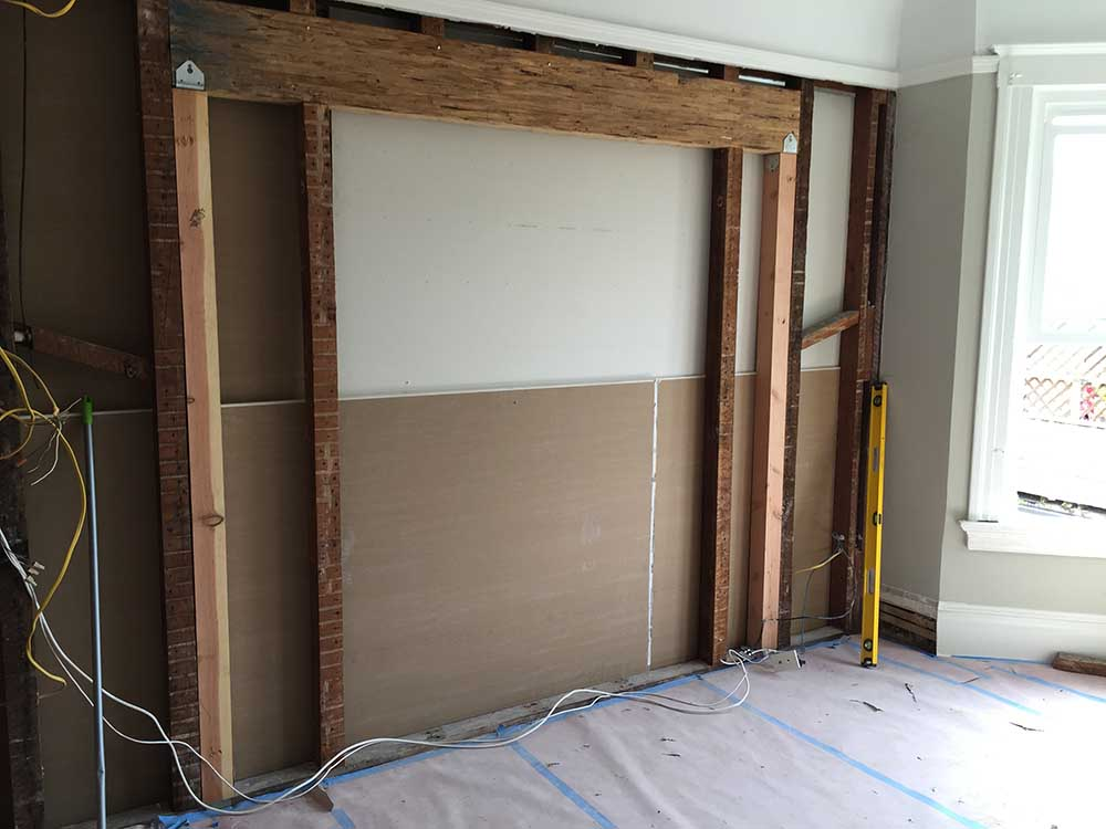 We needed to break through a wall to make space for the French doors that would open between the master bedroom and bathroom, and this is the structural preparation for that opening.
