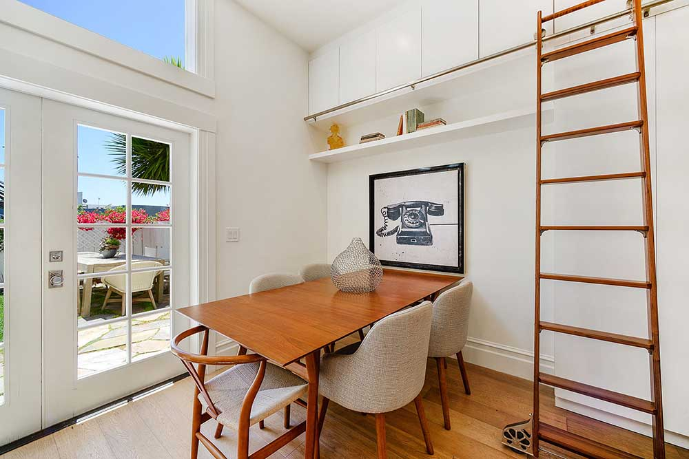 The ceilings downstairs are 13 feet tall, and we had cabinetry installed all the way to the top. We had this rolling ladder made in walnut wood, the same wood as the kitchen cabinetry, to allow easy access.