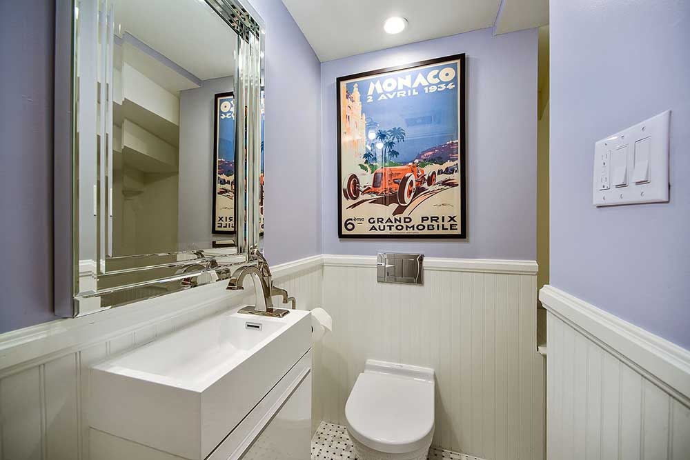 The wainscoting matches our master bathroom upstairs, and the floor is tiled in a marble basket-weave design.