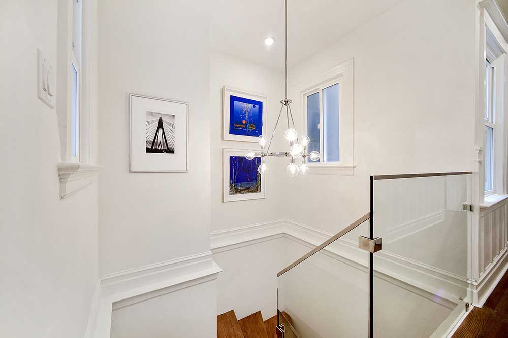Staircases provide such great gallery walls. The blue paintings are by the incredibly talented artist Paul Benjamins, who was a dear friend.
