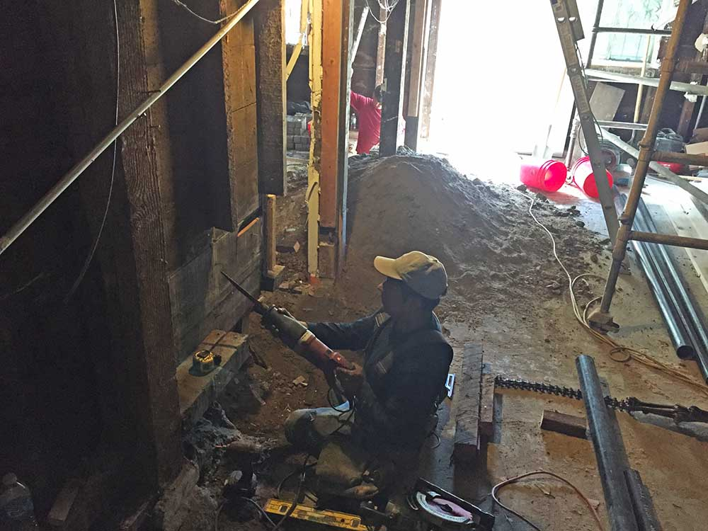 Breaking through walls to combine rooms.