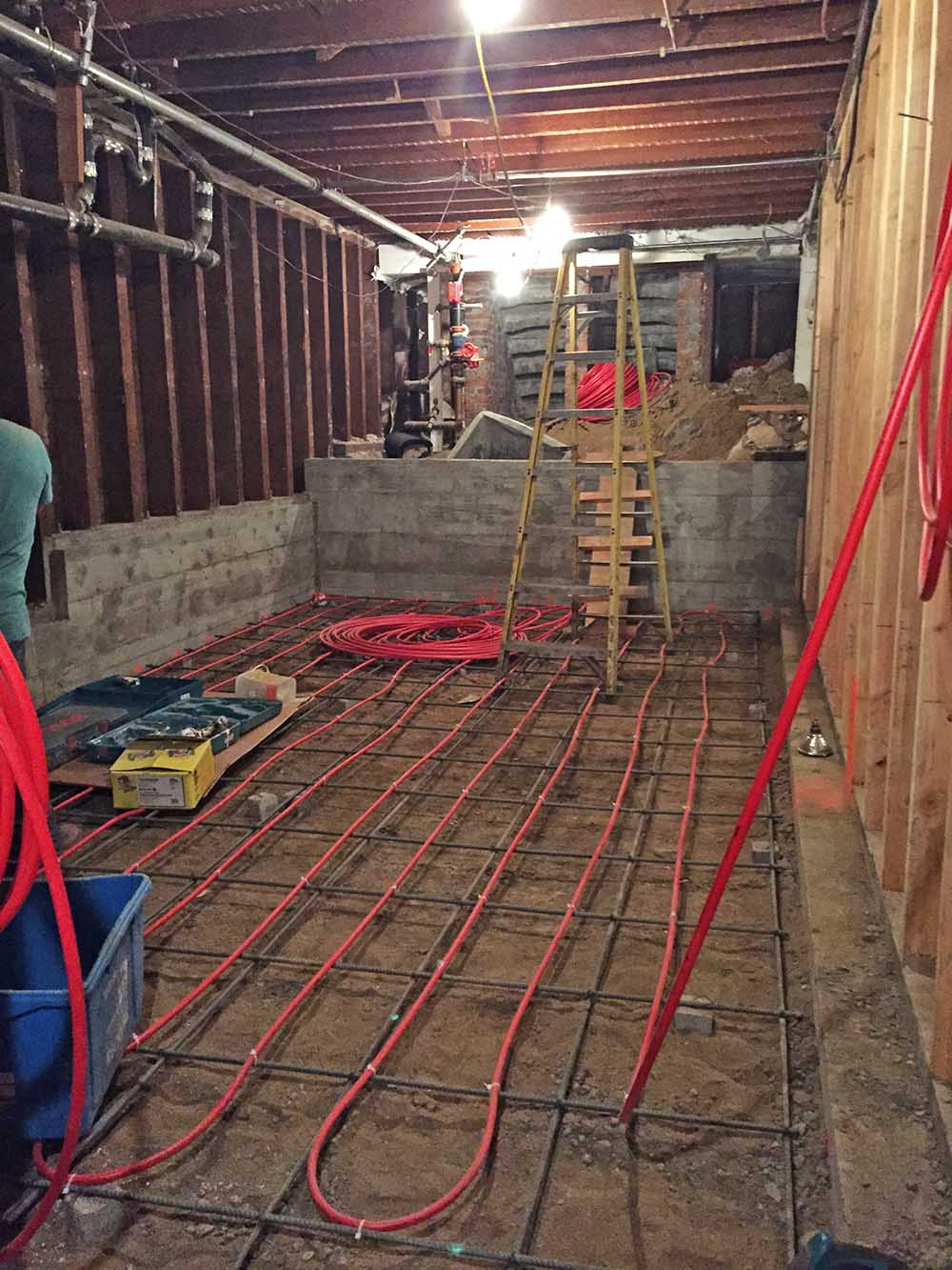 The underfloor heating is being installed, but there's not much natural light in here yet.