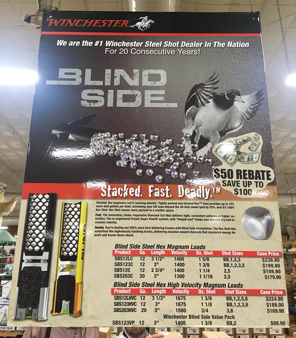 "This is one of the promotional posters we saw. The third paragraph reads:  ""Deadly. You're dealing with 250% more bird-blistering trauma with Blind Side ammunition. The Hex Shot hits waterfowl like high velocity tumbling bricks, delivering massive wound channels that maximize energy deposit and knock-down shock""."