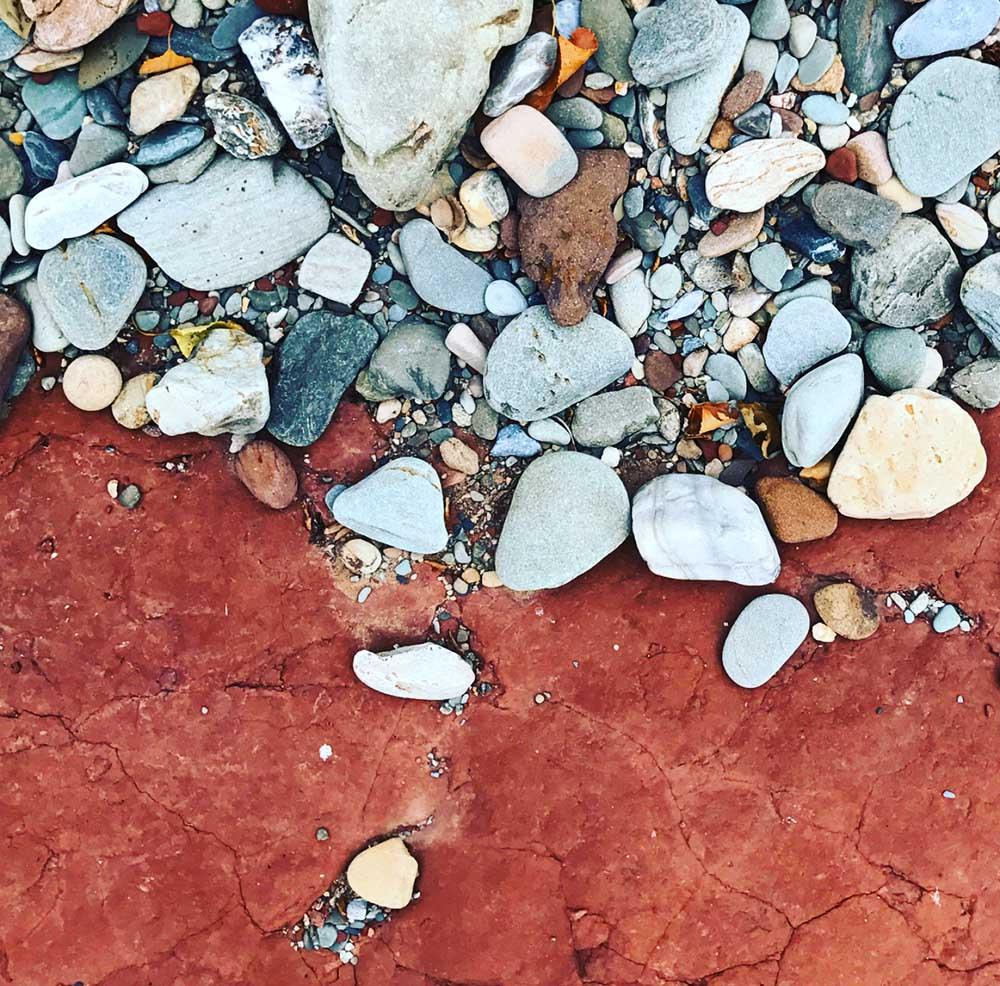 A close up of the stones along the riverbed. The Aveyron is famous for its beautiful red clay soil.
