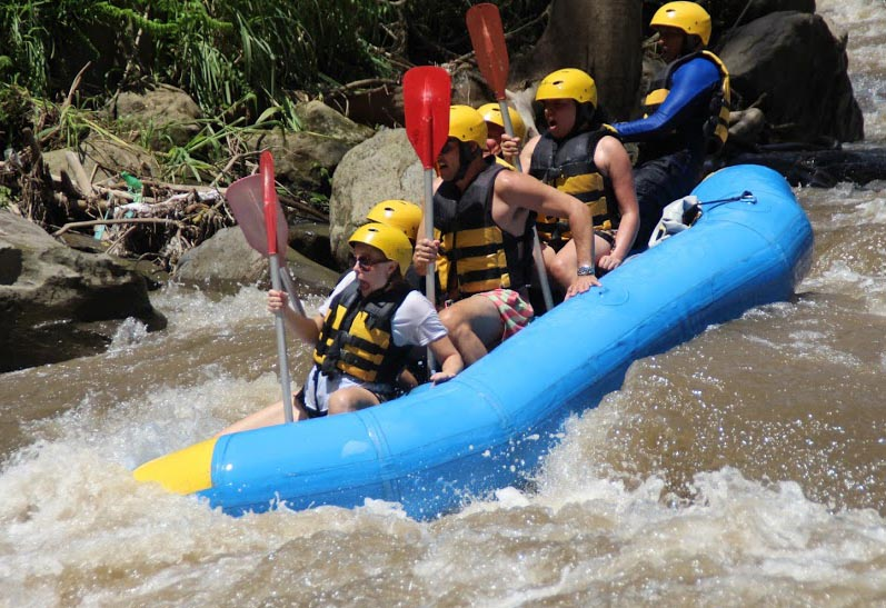 White water rafting... and yes, that person with their mouth wide open in the front, looking terrified, is me!