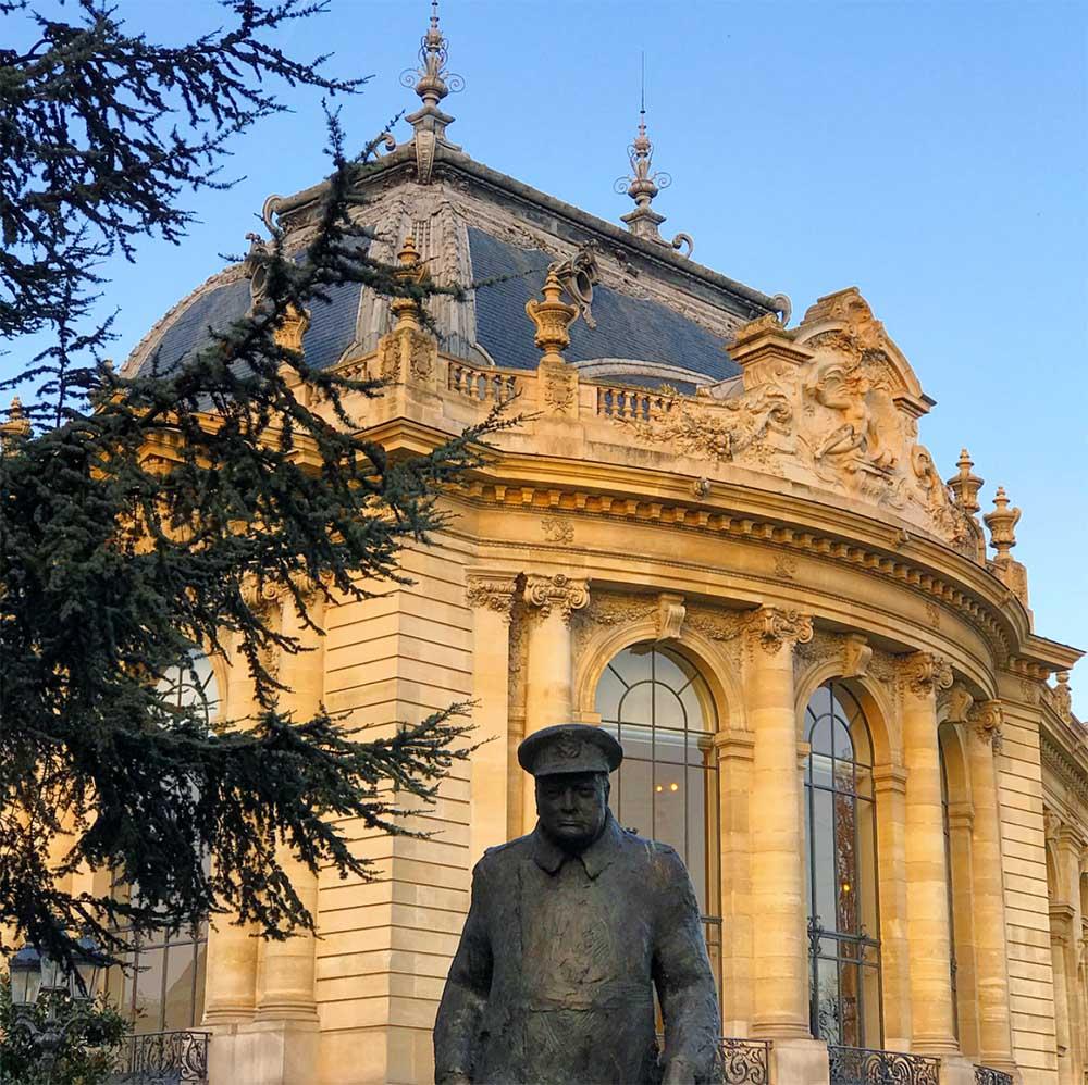A commanding statue of Winston Churchill outside the Petit Palais.