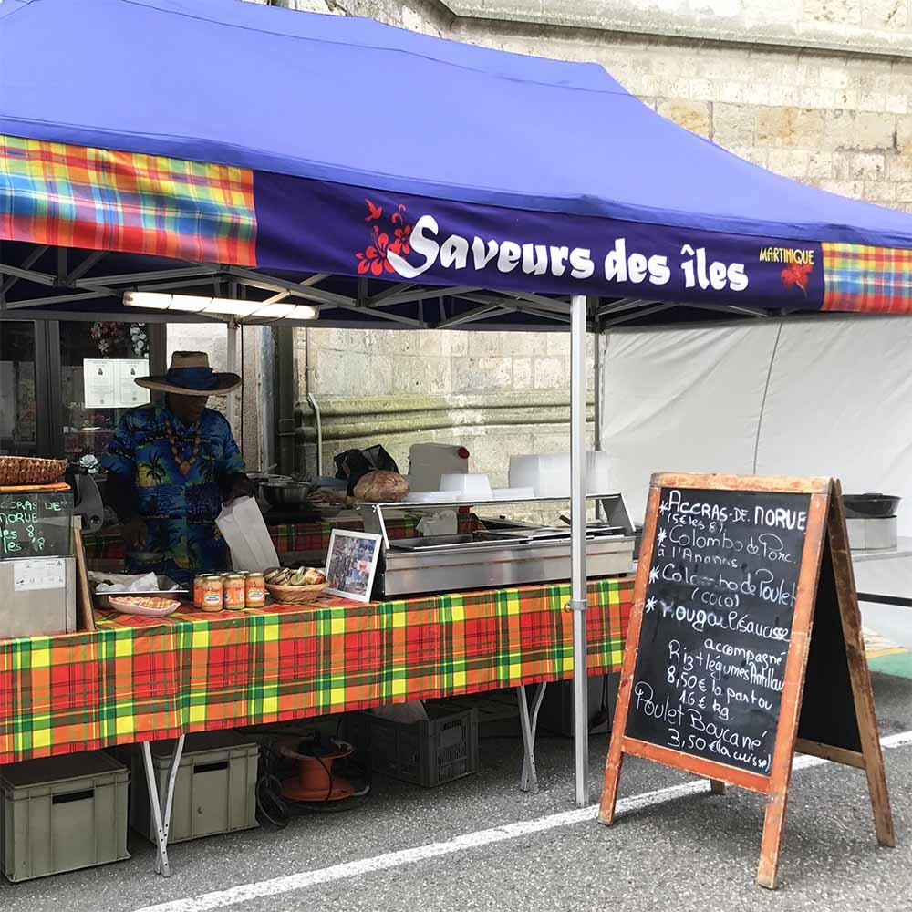 The market vendor selling the deliciois  Martinique  chicken stew!