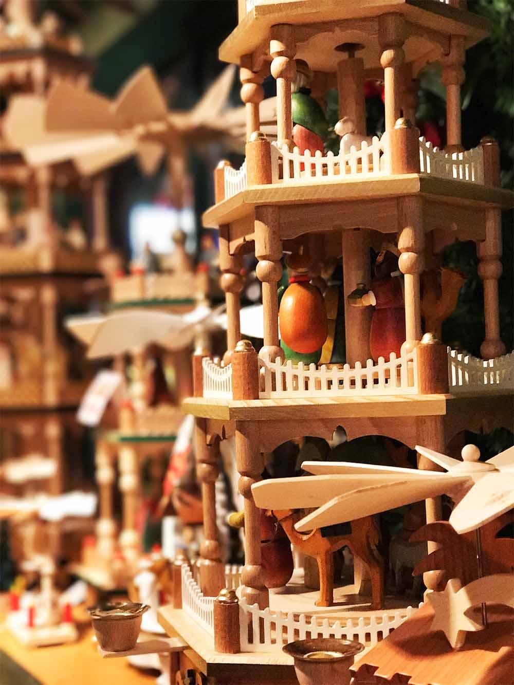 Traditional wooden Christmas pyramids on display.