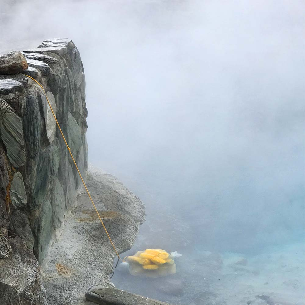 Our corn being cooked. Apparently these geothermal waters are rich in all sorts of healing minerals.