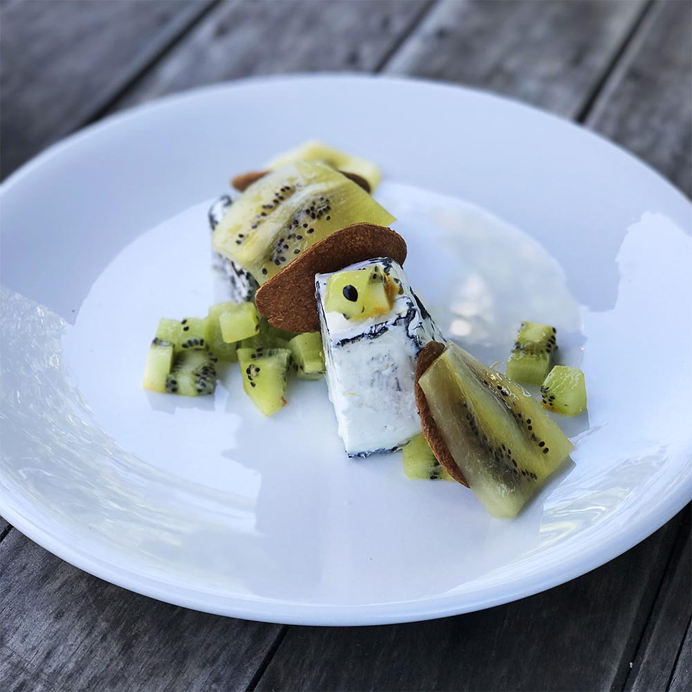 Cranky Goat cheese served with crackers and ripe kiwi fruit. YUM.